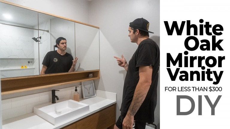 Man Talking about he built a diy White Oak bathroom vanity with glass doors for less than $300