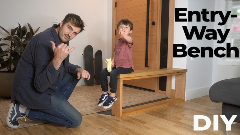 man teeing sons shoes on a bench he just built