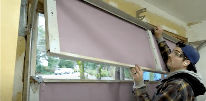 removing the top panel of a garage door