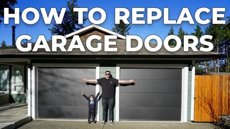 standing in front of newly installed garage doors