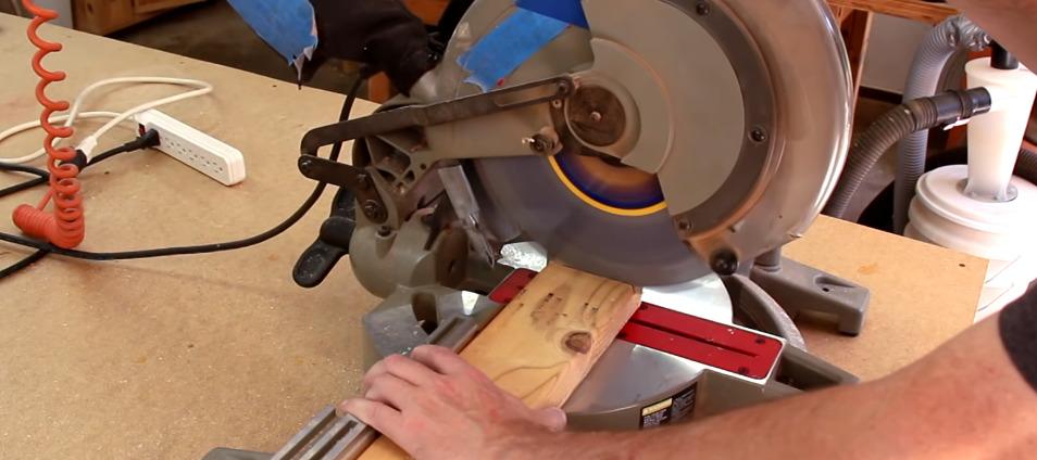 miter saw blade cutting through wood