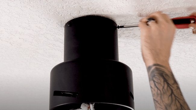 screwing motor canopy to ceiling mount